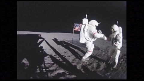 Astronauts Stand By American Flag