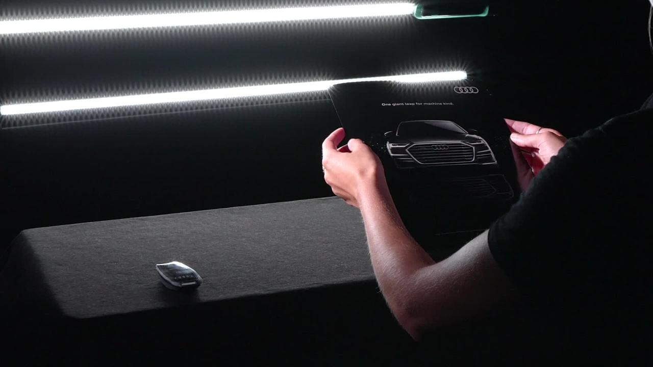 Departures magazine is sending out key fobs for an OLED-animated Audi ad