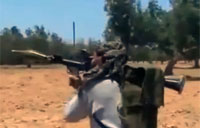 Rebels Exchange Fire with Gaddafi Forces