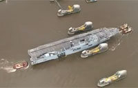 HMS Ocean Squeezes by Thames Barrier