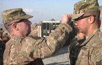 Father Promotes Son in Afghanistan