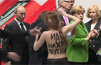 Topless Protester Goes After Putin!
