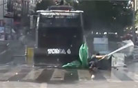 Police Panzer Plows Over Protester