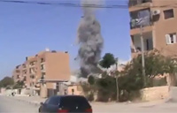 Parachute Bomb Hits Residential Area