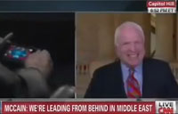 McCain Plays Poker During Syria Hearing