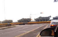 Train Transporting Military Vehicles
