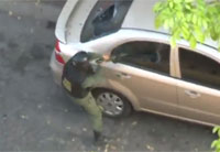 Venezuelan Soldier Vandalizes Car