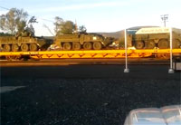 Combat Vehicles Hitch Ride on Train in Oregon