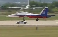 Lamborghini Drag Races Su-27 Fighter