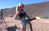 Woman Shoots a Minigun from the Hip
