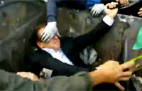 Ukrainians Throw Politician into Dumpster