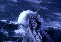 French Navy Frigate Takes On Huge Swells