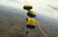 Leap Frogs Parachute Jump at F1 Race