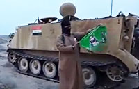 Iraqi Army Leaves U.S. Weapons for ISIS