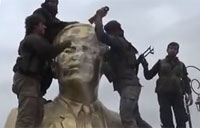 Rebels Smash Statue of Hafez al-Assad