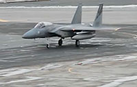 F-15 Eagles Take Off in Icy Conditions