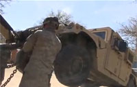 M984 Wrecker Towing Armored Humvee