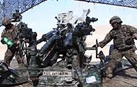 U.S. Army Artillerymen Firing the M Triple 7 Howitzer