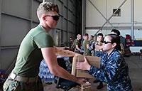 Sailors and Marines Unload Water, Food at NAS Key West
