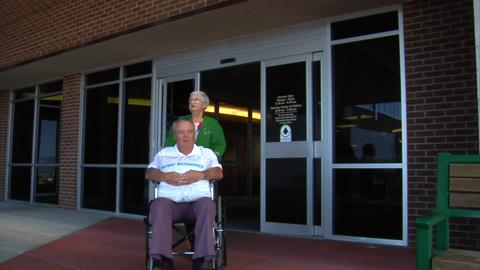Patient Leaving Hospital In Wheelchair