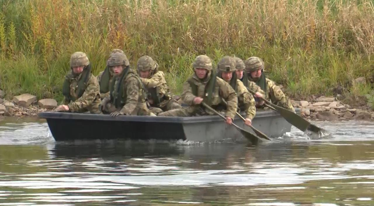 British Troops Show Off Amphibious Skills In River Crossing