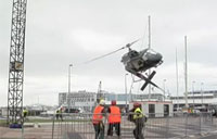 Workers Almost Killed by Heli Crash