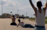 Activists Taunt Tanks with Their Bodies