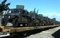 Lots of Humvess on a Train in L.A.