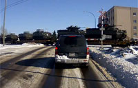 Canadian Army Equipment Rolls By