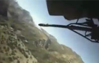 Apache Takes Fire from Taliban Militants