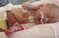 Deployed Soldier Sees Twins Birth