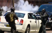 Riot Cops Take Out Bomber Suspect