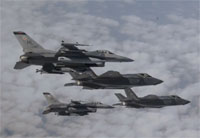 F-35's and F-16's Fly in Formation