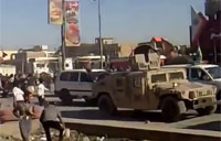 Iraqis Throw Stones as Army Retreats