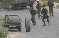 Israeli Soldier Knocked Down by Tire
