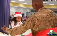 Soldier Pops Out of Present for Christmas Surprise