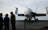 Pilots Learn to Land Hornet on Carrier