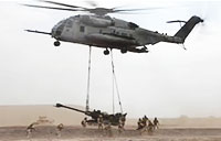 CH-53E Transports Howitzer