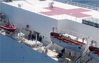 USNS Comfort Helo Transports Patient From Shore to Ship for Care
